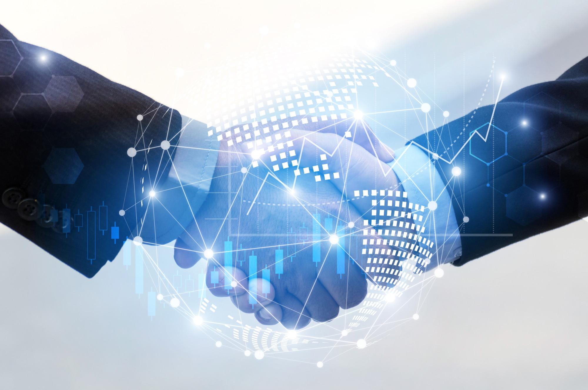 tech symbols over handshake