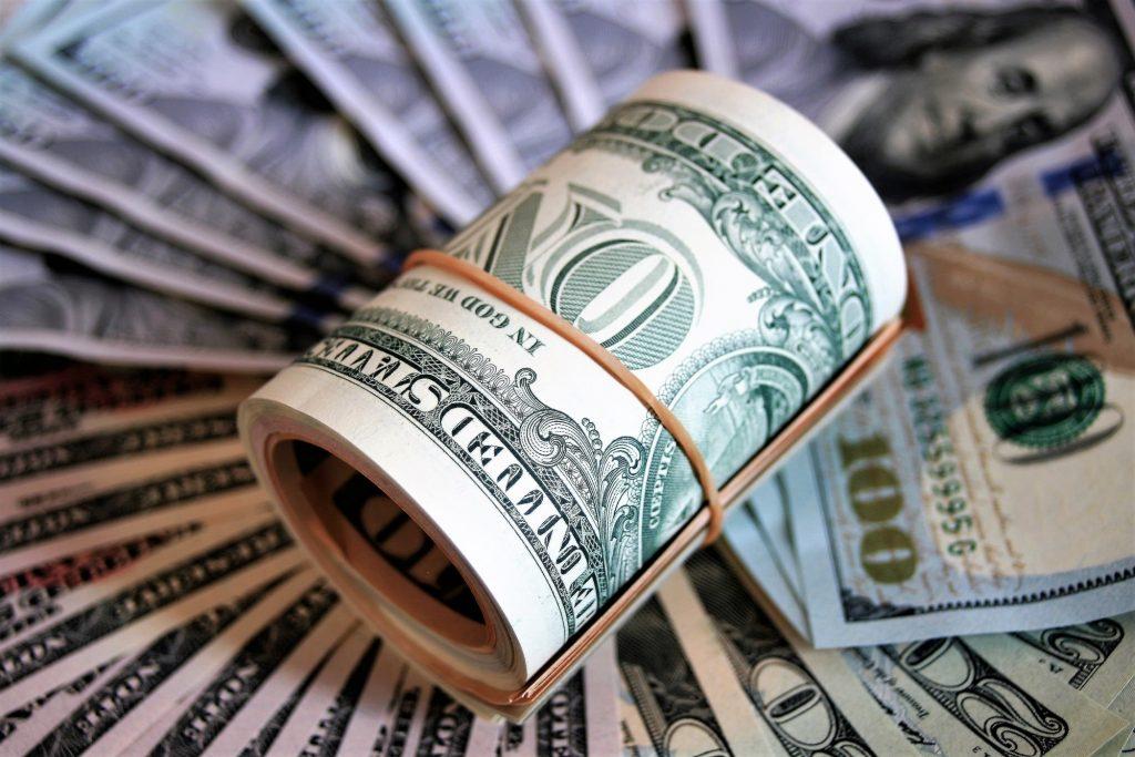 money roll and fan of bills