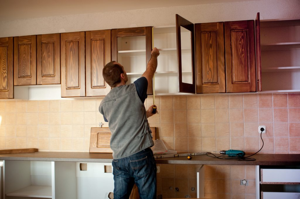 Architect Checking Cabinets for Home Remodeling