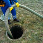 Professional Cleaning a Septic Tank Using a Pump